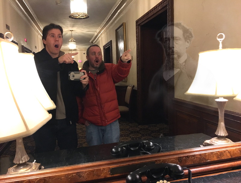 The ghost of Charles Dickens in the mirror at the Parker House Hotel poses with cardboard cutouts of Jeff Belanger and Ray Auger.