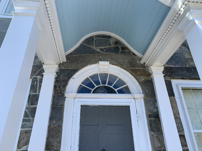 """The side-door of Hearthside House. Could the faint """"P"""" over the door be for Smith's lost love?"""
