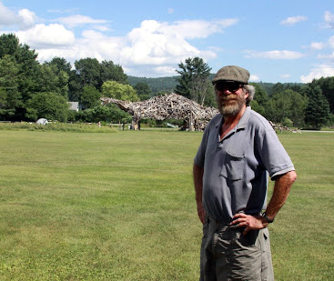 Brian Boland with the Vermontasaurus at the Post Mills Airport.